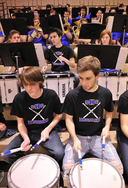Jacob Grimes, left, and James Nield pound on their drums with the band during the halftime of the Broncs' game against Gillette Friday night at Sheridan High School.