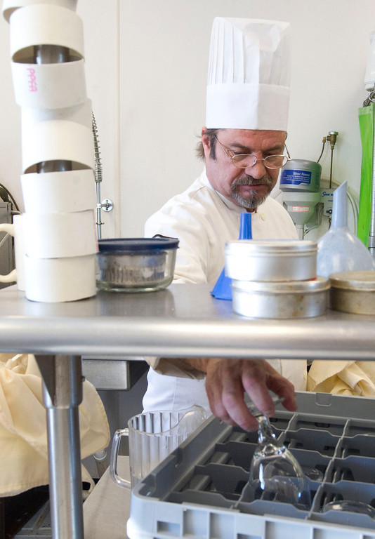 Culinary student Mark Hokanson takes his turn during the rotation cleaning dishes Thursday at the Wyoming Culinary Institute on South Sheridan Avenue.