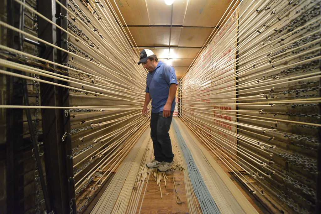 Dan Morales walks on a set of ropes in the hot room in the basement of King Ropes on Tuesday. The hot room maintains a temperature of 130 degrees Fahrenheit to allow the ropes to stretch and flatten. In the summer time, longer ropes are taken to a field outside Sheridan to stretch under the sun. Morales has been with the King Ropes for 34 years.