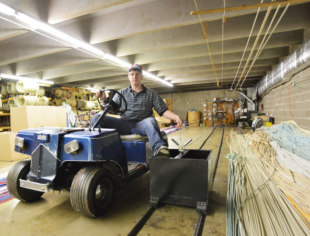 Dalton Basley pushes the Walk-line Rope Machine with a golf cart in the basement of King Ropes on Tuesday. The rope machine draws the cords across the room that will be twisted into a rope. King Ropes sells 30,000 ropes/year on average locally and by mail order. The ropes are a popular choice among ranchers, wranglers, and professional rodeo athletes world wide.