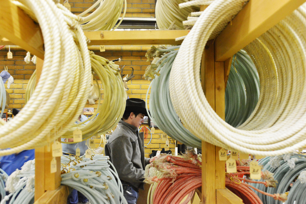 Cash Whitford of Montana examines a rope from the selection Tuesday at King Ropes in Sheridan. King Ropes sells 30,000 ropes/year on average locally and by mail order. The ropes are a popular choice among ranchers, wranglers, and professional rodeo athletes world wide.