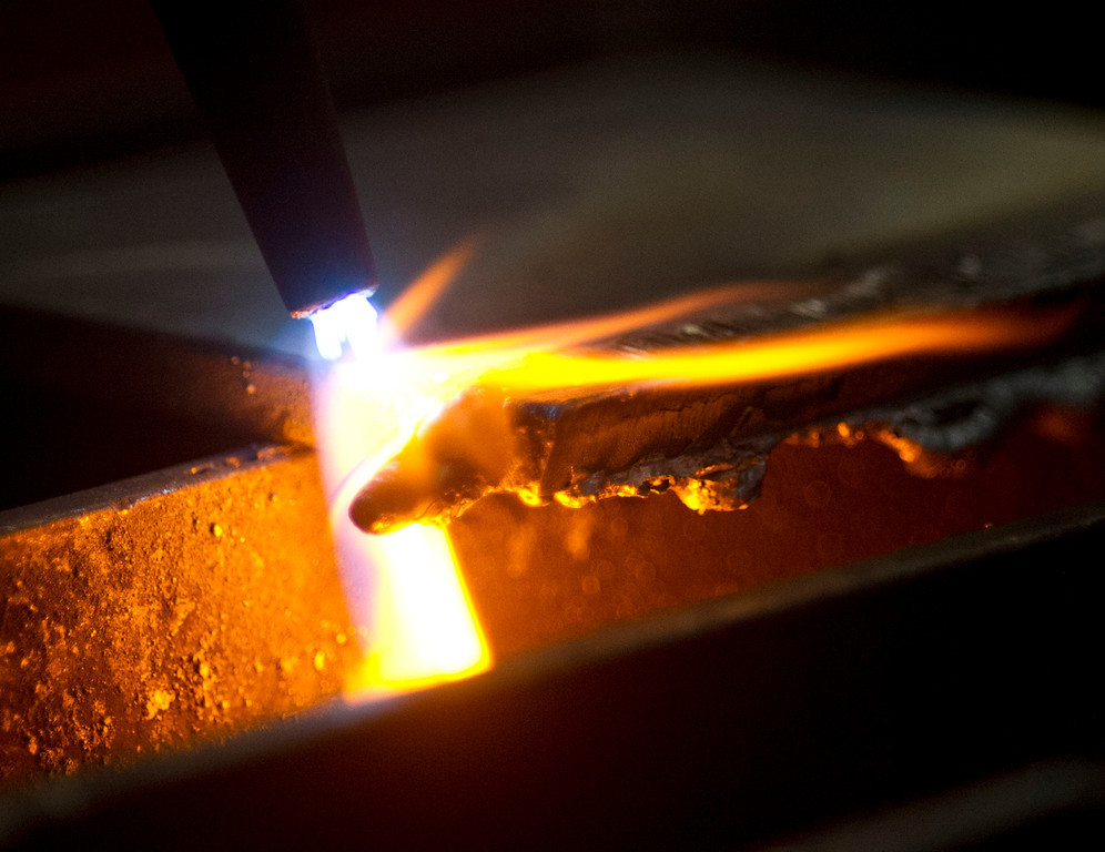 An Oxyfuel Thermal Cutting Torch slices through an inch-thick plate Wednesday at the Sheridan College Technical Center.