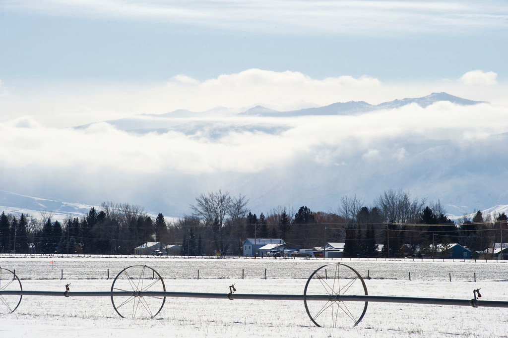A temperature inversion holds a layer of clouds in front of the Little Goose Canyon in the Bighorn Mountains Wednesday afternoon as seen from a field at Sheridan College.