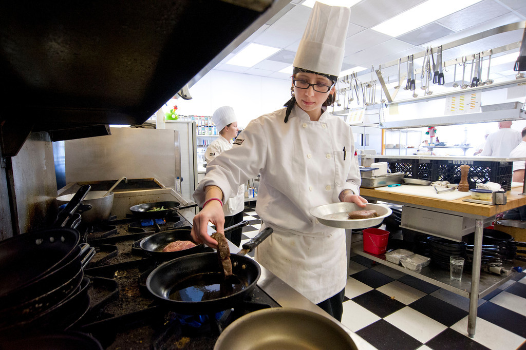 Elita Henderson places beef Tournedos on the skillet during lunch hour Thursday at the Wyoming Culinary Institute on South Sheridan Avenue. There are currently 24 freshmen and 12 second-year students enrolled through the Sheridan College's Culinary Institute. The restaurant is open Thursdays and Fridays from 11:30a.m. to 2p.m. and in the evenings from 5 to 8p.m.