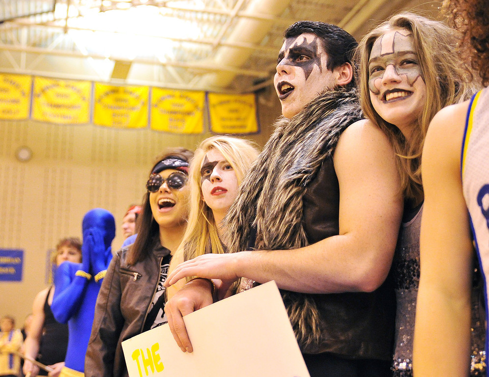 Sheridan rock and roll stars show their team spirit during Friday night's game against Gillette at Sheridan High School. From left, Becky Bridger, Drew Dafoe, Daniel Sessions, and Sarah LeTempt.