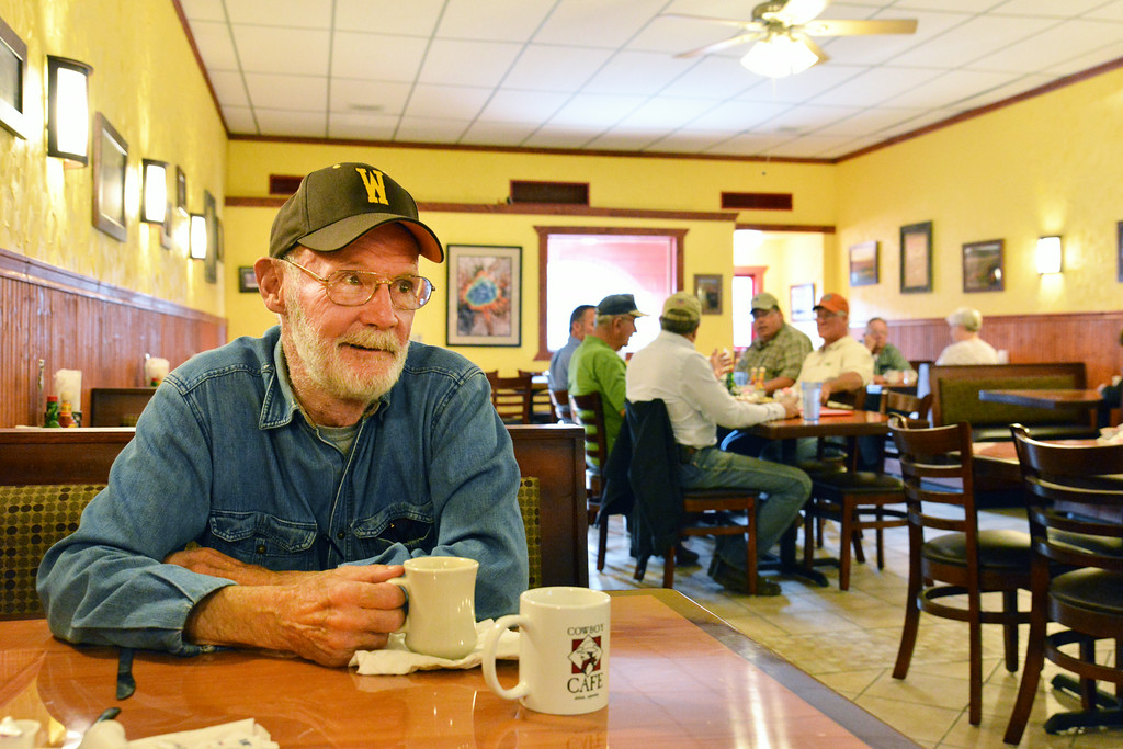 Bill Sangster enjoys a cup of coffee on the opening day at the Cowboy Cafe Tuesday morning on Main Street in Sheridan. Restaurant owners Robert Murdoch and Severine Murdoch of Dubois, Wyo., purchased and renovated the old Palace Restaurant location this past winter to extend their business to Sheridan. The Cowboy Cafe will be open at 7 a.m. everyday of the week. The owners have not established the closing time.