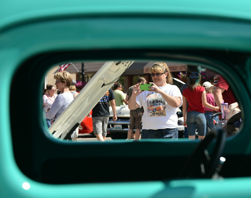 Windy Crivello takes a photo with her smartphone during the Karz Rod Run car show Saturday morning on Main Street.