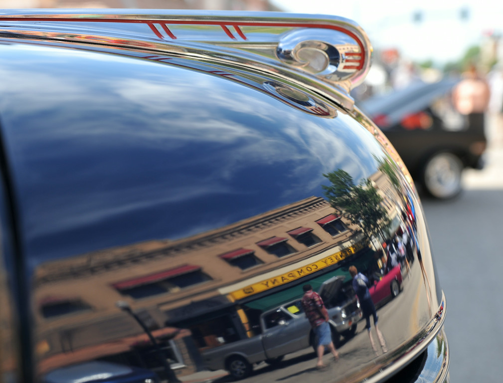 Car enthusiasts walk around show cars during the Karz Rod Run car show Saturday morning on Main Street.