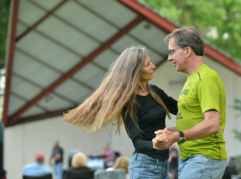 Gina Ablard, left, and Bryan Todd dance with the Smokehouse performance during the Concert in the Park Tuesday evening at Kendrick Park.