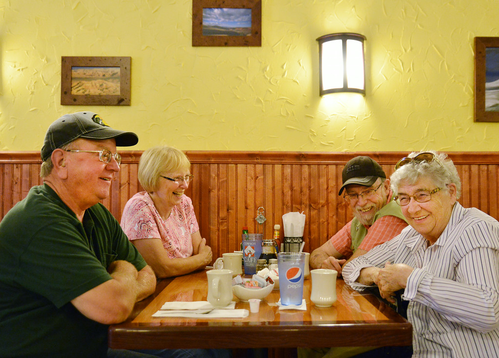 Restaurant guests, from left, Jon Podgornik, Peggy Campbell, George Campbell, and Louise Ralston visit with each after finishing breakfast on the opening day at the Cowboy Cafe Tuesday morning on Main Street in Sheridan. Restaurant owners Robert Murdoch and Severine Murdoch of Dubois, Wyo., purchased and renovated the old Palace Restaurant location this past winter to extend their business to Sheridan. The Cowboy Cafe will be open at 7 a.m. everyday of the week. The owners have not established the closing time.