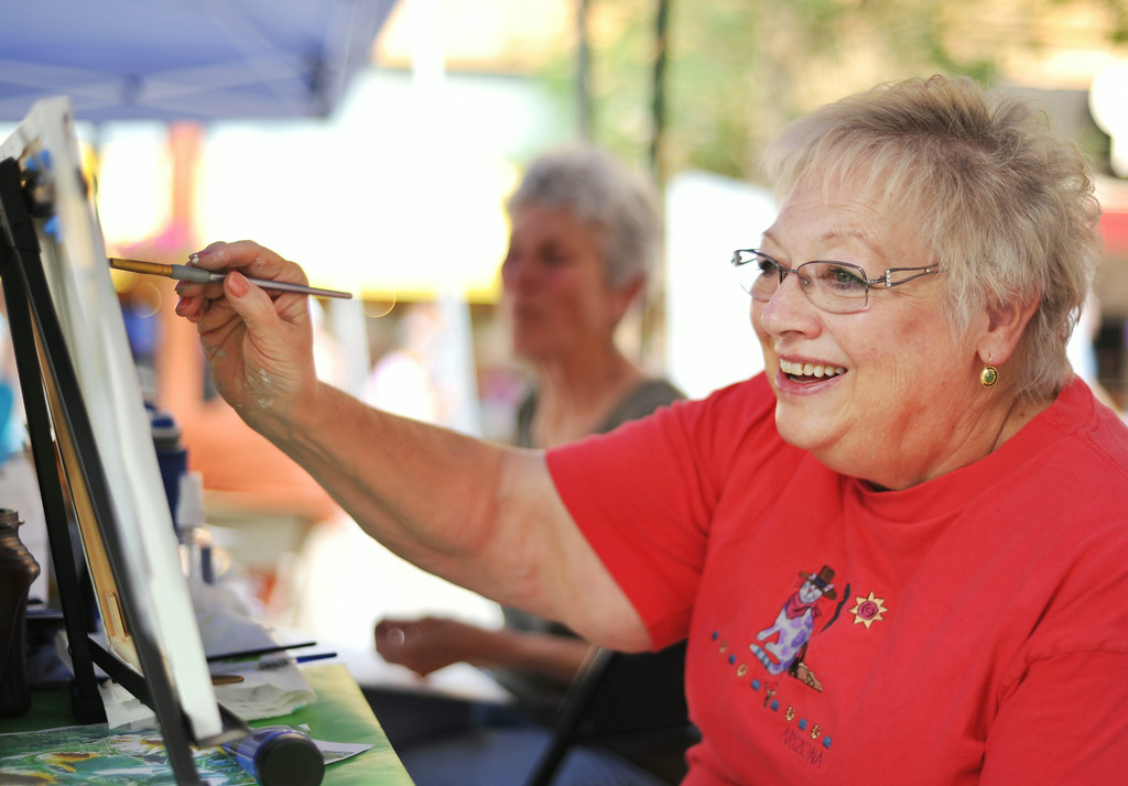 Local artist Pam Bridger paints a watercolor from the Sagebrush Artists Guild booth during the Third Thursday Street Festival on Main Street. The Sheridan Press|Justin Sheely.