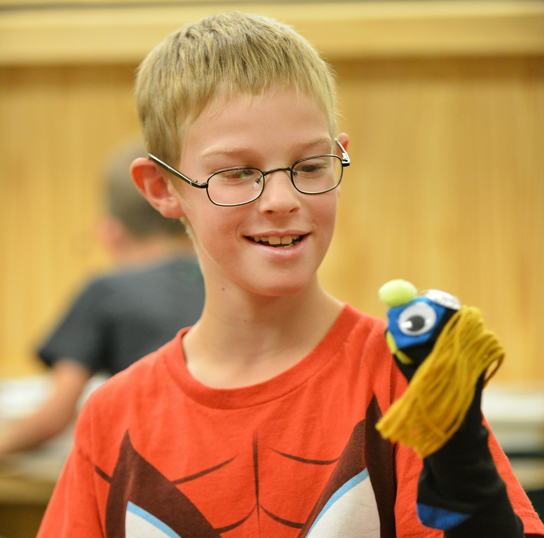 Second grader Brayden Sherrill plays with his sock puppet during the 'Summer Bridges' summer school enrichment program Wednesday at Tongue River Elementary School in Ranchester. TRE students made puppet socks and learned how to manipulate stick puppets with string to perform a marionette puppet show. The Summer Bridges program is a state grant to fund summer school programs, which are geared towards a balance of remediation and enrichment.