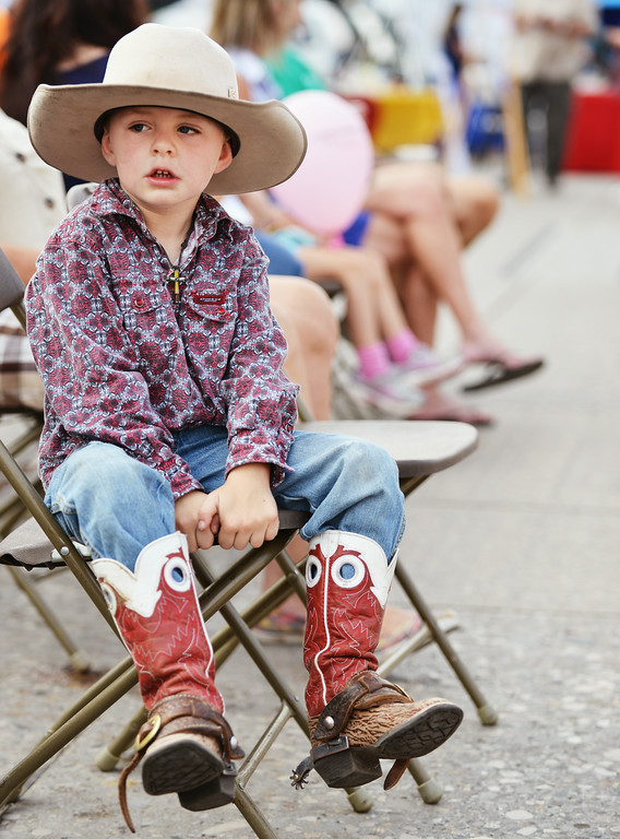 Four-year-old Colter McCright shows off his cowboy attire during the Third Thursday Street Festival on Main Street. The Sheridan Press|Justin Sheely.