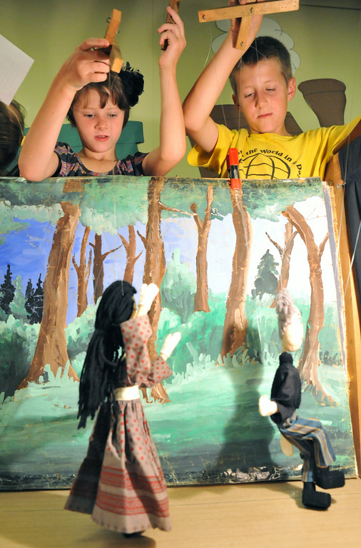 Siblings Sydni McArthur, second grade, left, and Carsen McArthur, a sixth grader, play with marionette puppets during the 'Summer Bridges' summer school enrichment program Wednesday at Tongue River Elementary School in Ranchester. TRE students made puppet socks and learned how to manipulate stick puppets with string to perform a marionette puppet show. The Summer Bridges program is a state grant to fund summer school programs, which are geared towards a balance of remediation and enrichment.