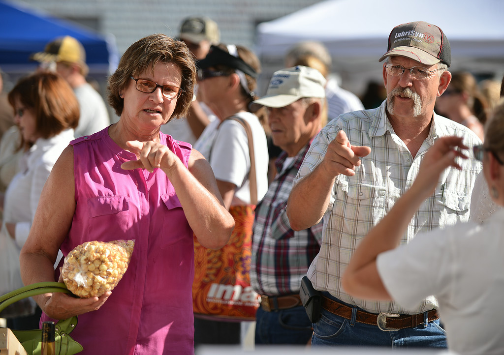 Debbie Sharp, left, and Grover Sharp order lemonade from a vendor during the Farmers Market Thursday evening on Grinnell Street. The Farmers Market is held every Thursday from 5 p.m. to 7 p.m. on Grinnell Street through September. The Sheridan Press|Justin Sheely.