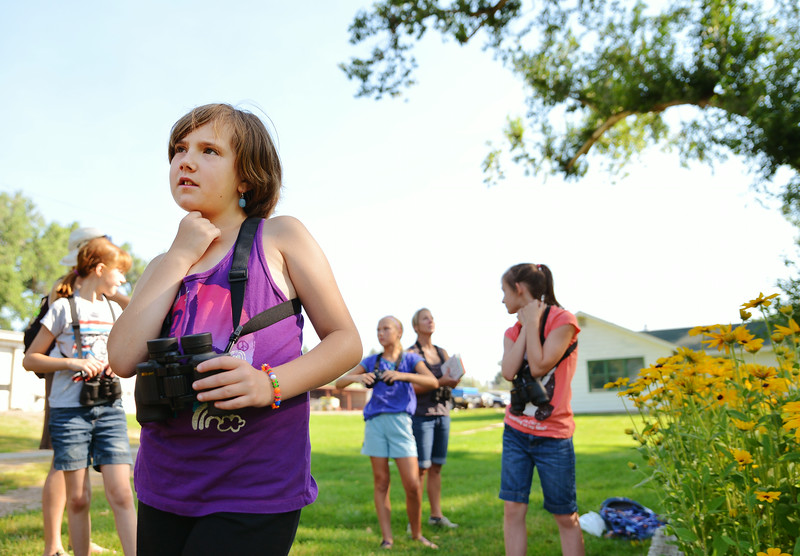 Nine-year-old Madison Thompson, middle, looks around for birds during the Science Kids birding trip to the Padlock Ranch Thursday in Dayton. The students exercised birding skills and installed bird boxes on the ranch before hitting the Dayton Pool to beat the heat. The Sheridan Press|Justin Sheely.
