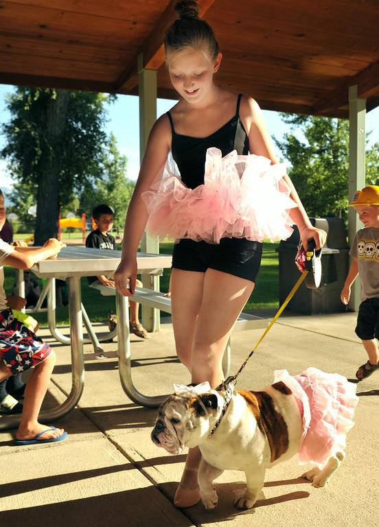 Twelve-year-old Rheagan Logan walks her English Bulldog Mushroom dress in tutus through the Pet Parade during the 38th annual Dayton Days Friday evening at Scott Park in Dayton. The Sheridan Press|Justin Sheely.