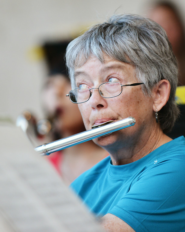 Bonnie Brady on Flute watches for her prompt from the director during the Concert in the Park performance by the Sheridan Concert Band Tuesday evening at Kendrick Park. The Sheridan Press|Justin Sheely.