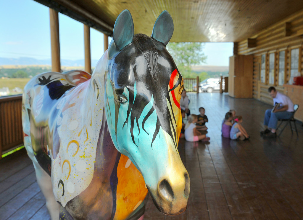 A statue of a painted horse stands near the group of children during Tidbit Tuesday at the Sheridan County Museum. Rodeo was the theme this month; the children decorated paper cowboy boots that will be displayed at the museum.