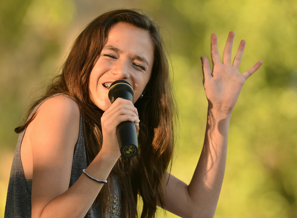 Fourteen-year-old Nikki Perfetti sings on stage for the 'Tongue River Counting Stars' talent show during the 38th annual Dayton Days Friday evening at Scott Park in Dayton. The Sheridan Press|Justin Sheely.