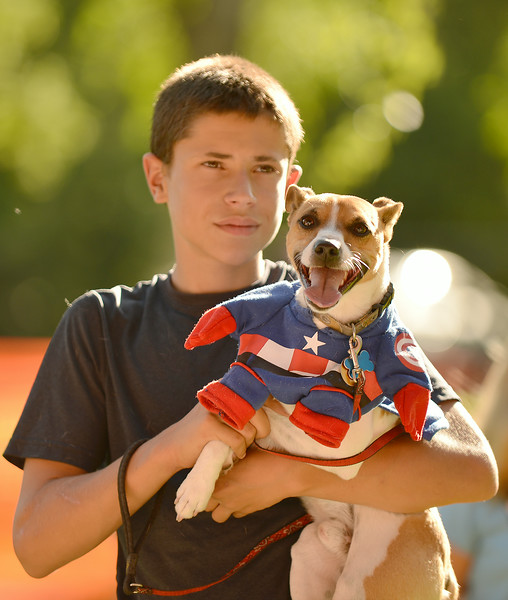 Twelve-year-old Cooper Vollmer holds his shy dog Rex for the Pet Parade during the 38th annual Dayton Days Friday evening at Scott Park in Dayton. The Sheridan Press|Justin Sheely.
