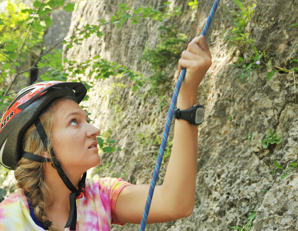 K-LIFE's Allie Jost belays for a climber during the K-LIFE rock climbing trip to Piney Creek Canyon in Story. The trip was offered for free by K-LIFE for the youth–many of which had never climbed before. The Sheridan Press|Justin Sheely.