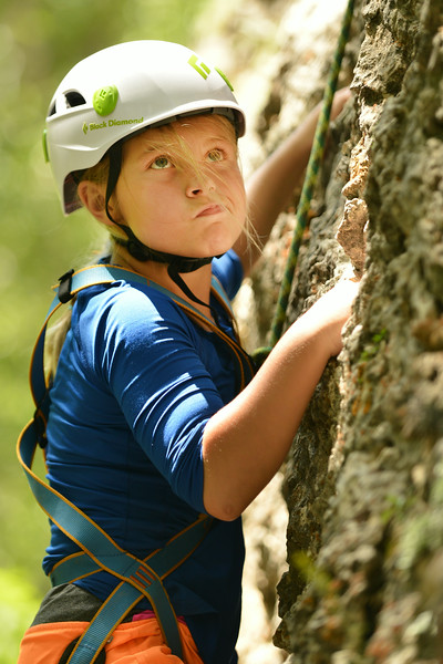 Ten-year-old Aubrey Cooper pause to consider the path as she ascends the rock wall during the K-LIFE rock climbing trip to Piney Creek Canyon in Story The trip was offered for free by K-LIFE for the youth–many of which had never climbed before. The Sheridan Press|Justin Sheely.