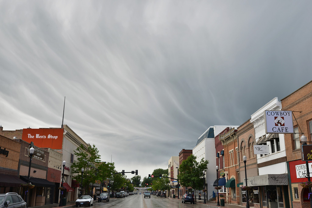 Wind flow and stability patterns cause a wave-like appearance in the clouds above Main Street after the rain clears Wednesday morning.