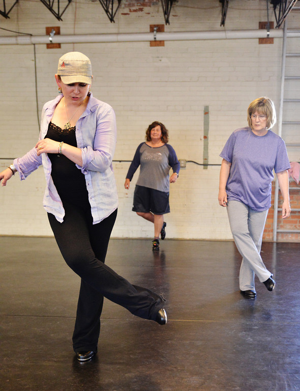 Dance instructor Aunie Johnson, left, and students Cathy Bradford, middle, and Donna Wilson move to the music during a tap dance class Wednesday at the Fly Dance Artistry dance studio on North Gould Street.