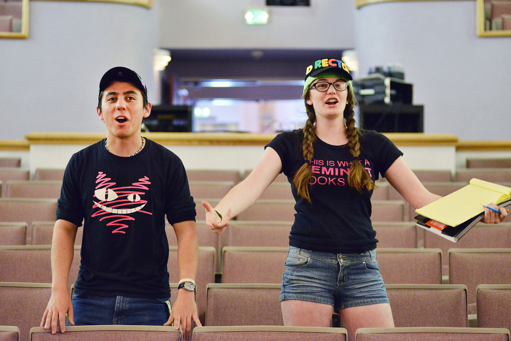 "Co-directors Tyler Rogers, left, and Emma Hall encourage the children to display more energy and excitement as they rehearse a musical number for ""Annie Jr."" Tuesday at the WYO Theater. This will be the third Annie Jr. performance in Tandem production's 20-year anniversary in Sheridan. Curtain is at 7:30 p.m. June 18 – 21 at the WYO Theater."