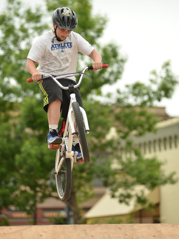 Fourteen-year-old Seth Orlandi jumps his bike off the ramp during the 'Sheridan Takeover' free skate clinic Saturday afternoon on Grinnell Plaza. The event was to be a positive influence for Sheridan youth and to teach new bike and skateboard tricks. The events were sponsored by The Sports Stop, Sheridan K-Life, and local churches.