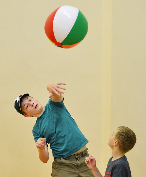 Big Horn Elementary fifth grader Gentry Lattin the ball as the students play hot potato in a racquetball court during the Big Horn Elementary Fun Day Wednesday at the YMCA. Today is the last day of school for Sheridan County School District 1.