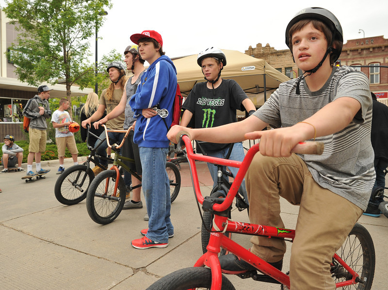 Fourteen-year-old Dawson Olson, right, watches with his friends as the Skate Church members perform bike jumps during the 'Sheridan Takeover' free skate clinic Saturday afternoon on Grinnell Plaza. The event was to be a positive influence for Sheridan youth and to teach new bike and skateboard tricks. The events were sponsored by The Sports Stop, Sheridan K-Life, and local churches.