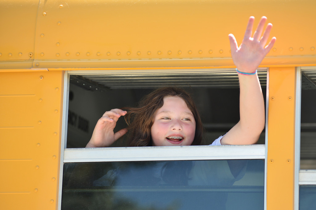 Rudi Balstad waves goodbye at the students and teachers gathered outside during the early dismissal on the last day of School Thursday at Tongue River Elementary School.