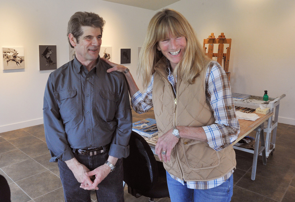 Resident artist Gordon McConnel of Billings, Mont., left, and local chef Cindy Brooks visit in McConnel's studio during the Open Studios tour Saturday at the Ucross Foundation. McConnel worked on a series of acrylic paints based on pre-world war I era rodeo photographs.