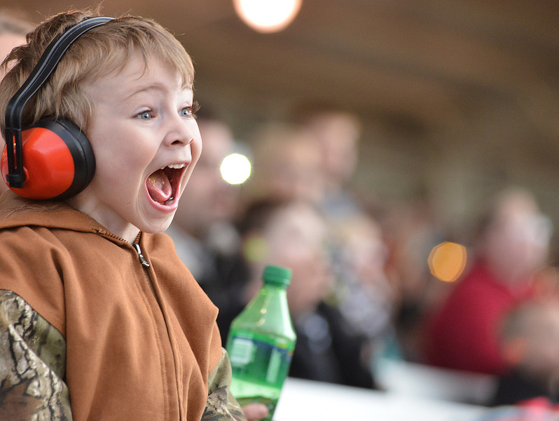 Four-year-old Bobby Laird screams with excitement as the monster trucks perform during the Mega Promotions Tour Monster Truck Show Saturday night at the Sheridan County Fairgrounds arena.