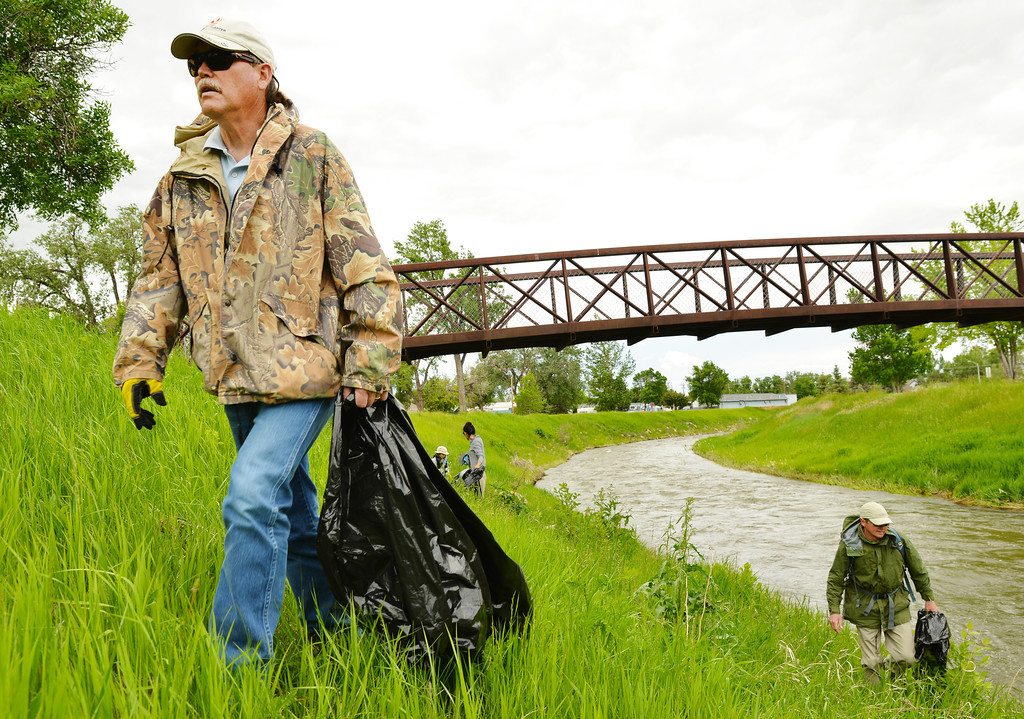 Northeastern Wyoming Program Director of The Nature Conservancy Rick Pallister, left, walks along the riverbank of the Little Goose for the Goose Creek Trail cleanup Wednesday at Washington Park. This is the first community cleanup event the Wyoming Chapter of The Nature Conservancy has done in Sheridan. Pallister says he wants to partner with local agencies to get more community involvement for future cleanup events along the riparian areas in Sheridan.