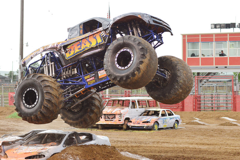 """The monster truck know as """"The Beast"""" performs a stunt during the Mega Promotions Tour Monster Truck Show Saturday night at the Sheridan County Fairgrounds arena."""