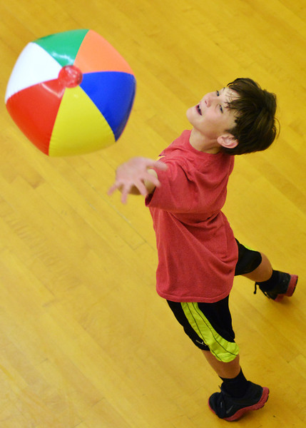 Big Horn Elementary fifth grader Bode Dunham hits the ball as the students play hot potato in a racquetball court during the Big Horn Elementary Fun Day Wednesday at the YMCA. Today is the last day of school for Sheridan County School District 1.