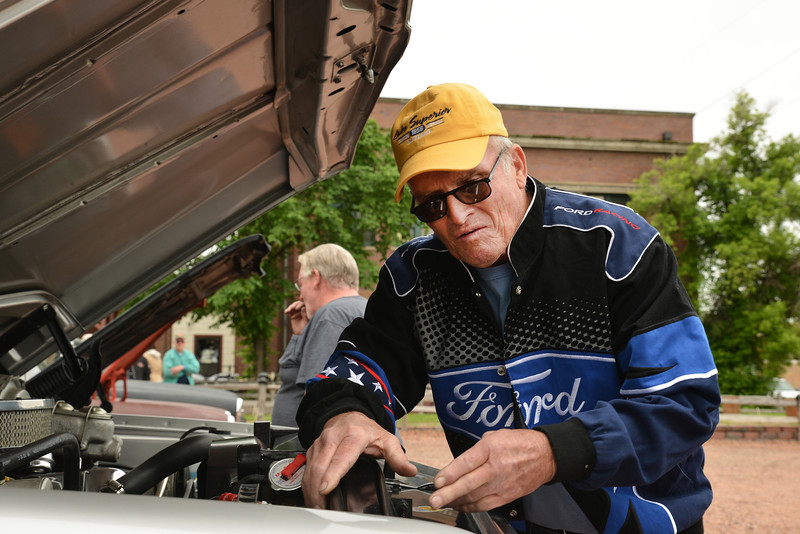 Joe Buskirk tinkers with his 1972 Chevy truck during the 'Cool Rides in a Cow Town' car show Saturday at Rails.