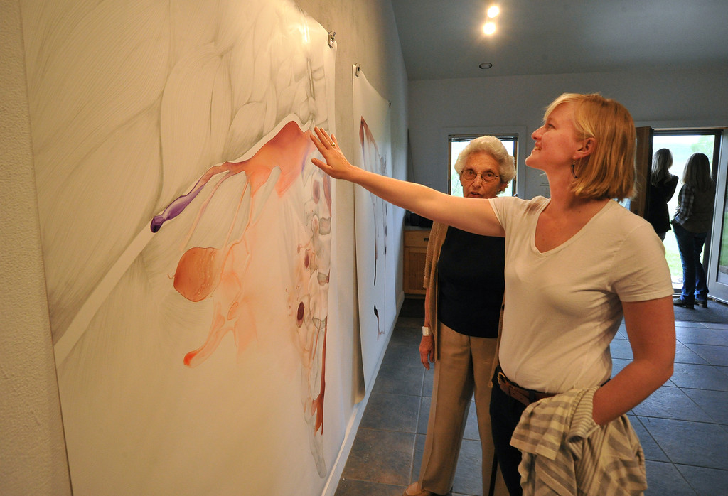 Barbara Bettigole of New Jersey, left, and Mina Brown look at art from resident artist Vesna Jovanovic during the Open Studios tour Saturday at the Ucross Foundation. Jovanovic's work is a combination of pencil and ink on a material called yupo.