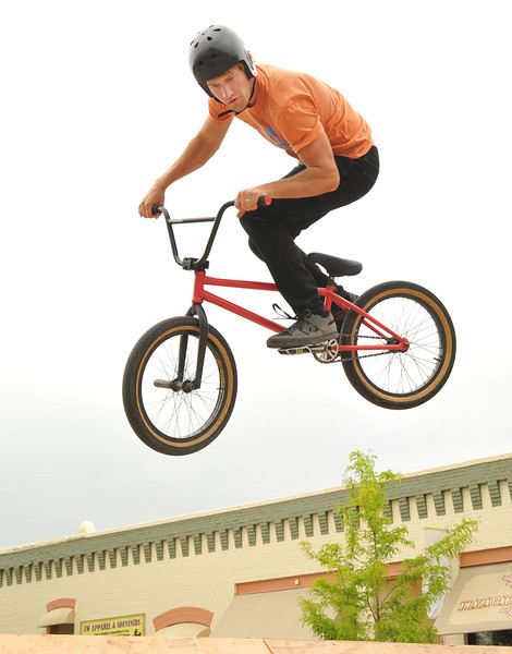 Skate Church member Josh Jost performs a stunt jump during the 'Sheridan Takeover' free skate clinic Saturday afternoon on Grinnell Plaza. The event was to be a positive influence for Sheridan youth and to teach new bike and skateboard tricks. The events were sponsored by The Sports Stop, Sheridan K-Life, and local churches.