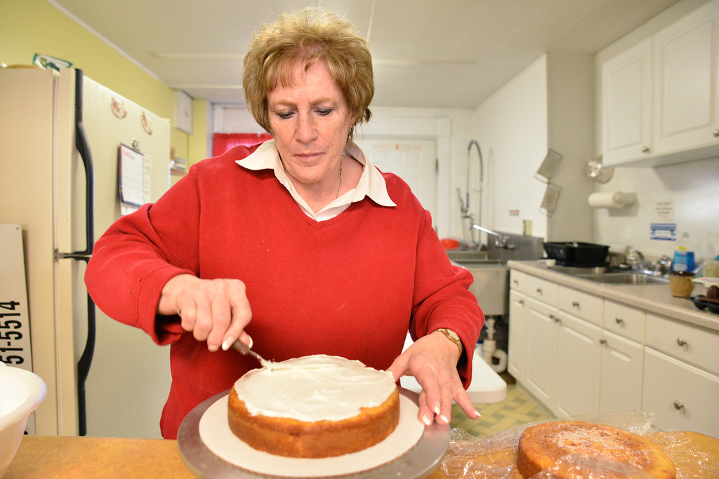 Marla Garriffa spreads a layer of frosting before stacking the next layer of a Red Raspberry cake Thursday at Marla's Cakes & Specialties on Main Street. Garriffa says that all of her cakes and products are made from scratch. Garriffa has been baking for 35 years.