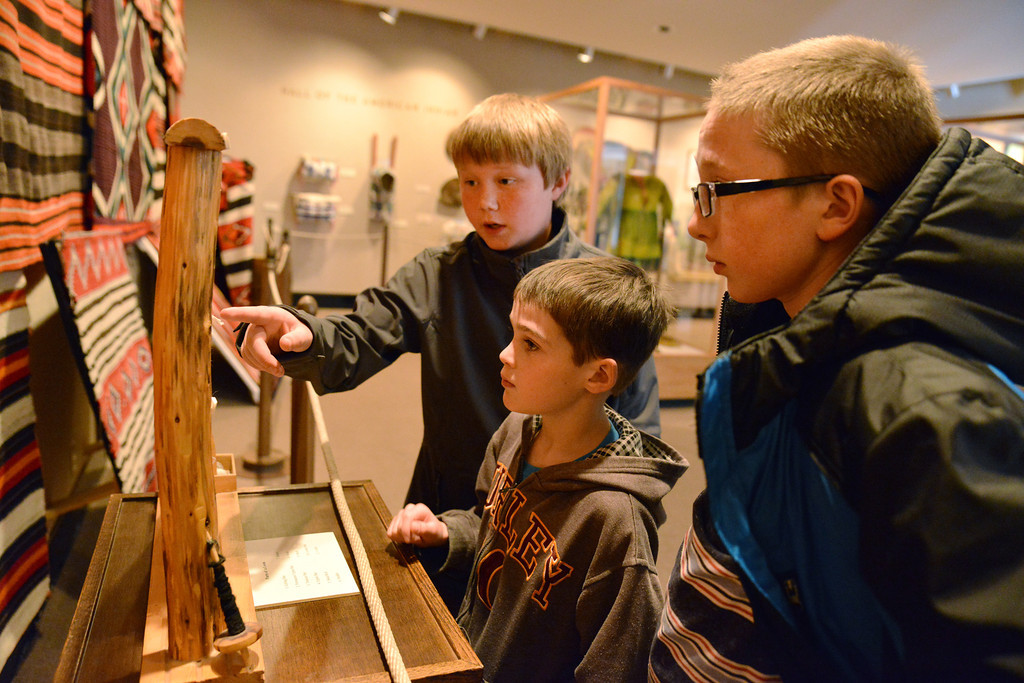 Big Horn Elementary fifth graders point to elements on a weaving loom at the Native American Exhibit Tuesday afternoon in the Brinton Museum. From left, Winfield Loomis, Brandon Cummins, and Braden West.