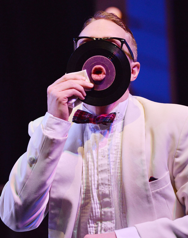 "Michael Gondal as 'Smudge' sticks his lips through an old vinyl record to entertain the audience as the others get ready for the next performance during the rehearsal of ""Forever Plaid"" Tuesday night at the WYO Theater. The musical performance by the Civic Theater Guild and the WYO Theater is directed by Matt Davis with musical arrangements by James Raitt will show at the WYO Theater March 20-22 & March 27-29 at 7:30p.m. Matinees are Sunday's at 2p.m. on March 23 and 30."