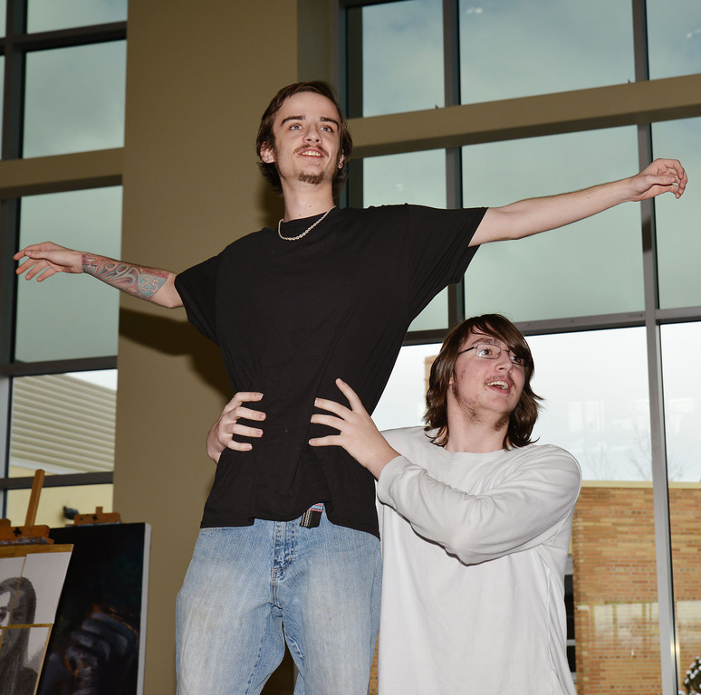 "Fort Mackenzie High School senior Michael O'Kelly, left, and Daniel Trace of Big Horn High School pose the iconic scene from the motion picture ""Titanic"" in the opening theater act during ""Reflections on Reflection"" Saturday afternoon at the Sheridan College Edward A. Whitney Academic Center atrium. The event featured student-lead interdisciplinary arts from the Sheridan College Art House, which included the Theater Department, Art Department and Music Department to interpret Shel Silverstein's poem ""Reflection."" The college students collaborated with high school students from Sheridan High School, Fort Mackenzie, and Big Horn High School for the performance."