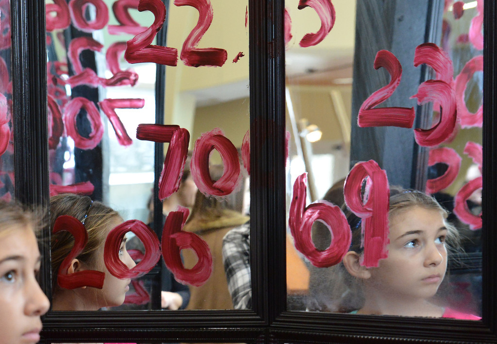 "Big Horn fifth grader Chrysanthi Paninos looks around inside the room of mirrors with painted numbers during ""Reflections on Reflection"" Saturday afternoon at the Sheridan College Edward A. Whitney Academic Center atrium. The numbers represent statistics on Wyoming youth regarding domestic abuse, suicides, drug overdose, and deaths from smoking, dunk driving, and texting while driving."