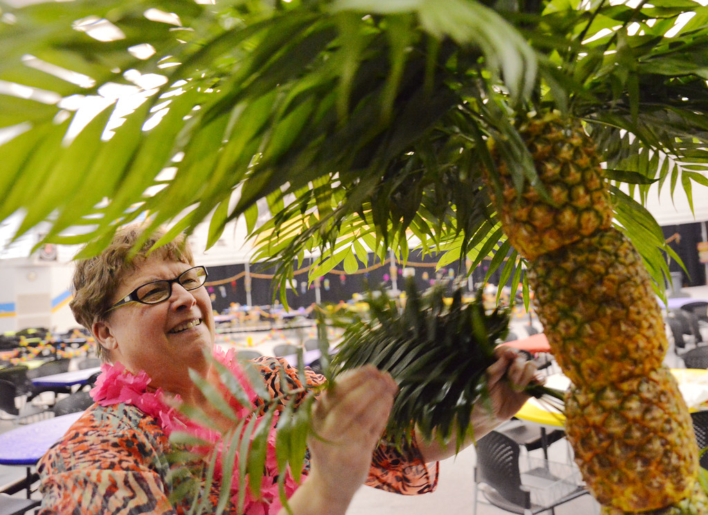 Sodexo Catering General Manager Ammie Whaley makes a pineapple tree at one of the booths in preparation for the Festival of Cultures Friday at the Sheridan College Golden Dome.