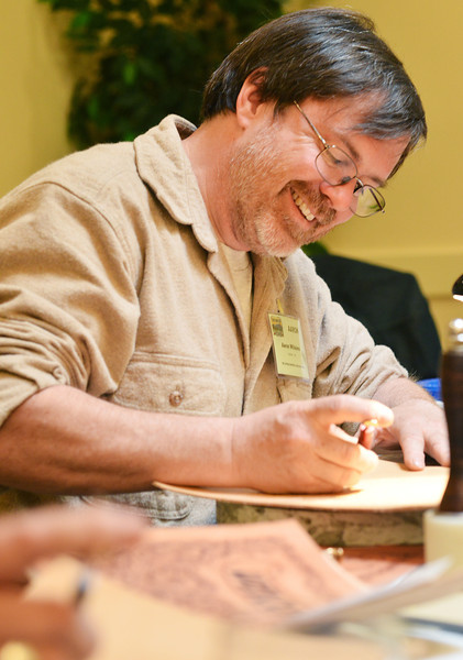 """Aaron Willaims of Gresham, Ore., runs cuts into a sheet of leather in a """"Sheridan Style"""" Leather Tooling workshop Tuesday during the Leather Crafters convention at the Holiday Inn."""