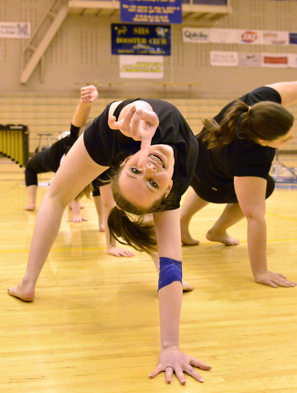 Hailey Longhurst holds a step with the Sheridan Bronc Cheerleaders during the talent show Wednesday at Sheridan High School.